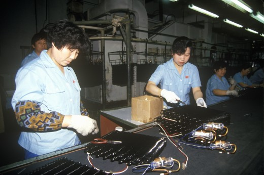 Stock Photo: 1599-14488 Factory workers at Shanghai Shangling Electric Appliances Company, Ltd., in Shanghai, People's Republic of China