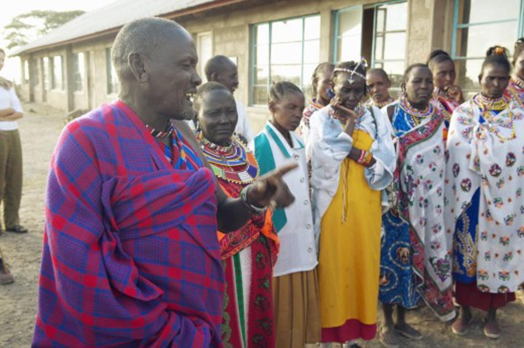 Chief speaking with gathering at village of Nairobi National Park, Nairobi, Kenya, Africa : Stock Photo