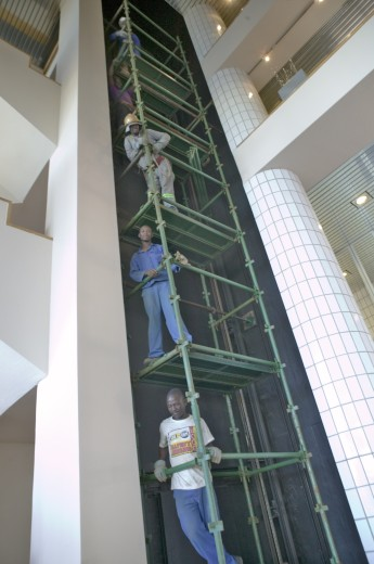 Hotel workers work on five elevator levels in Durban, South Africa : Stock Photo