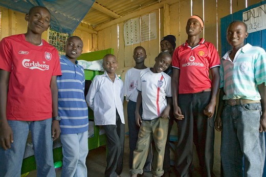 A group of young Kenyan males, who are affected with HIV/AIDS, pose for camera at Pepo La Tumaini Jangwani, HIV/AIDS Community Rehabilitation Program, Orphanage & Clinic.  Pepo La Tumaini Jangwani (wind of hope in the arid place) offers hope, support and care for orphan and vulnerable children living with HIV/AIDS in Nairobi, Kenya, Africa : Stock Photo