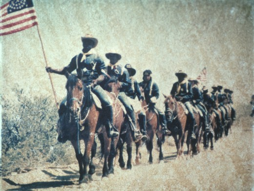 Stock Photo: 1599-1912 Historical reenactment of U.S. cavalry on horseback with American flag