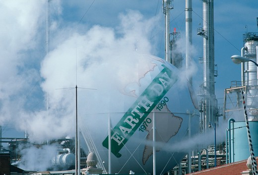Earth day sign at an oil refinery, Los Angeles CA : Stock Photo