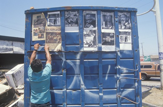 Stock Photo: 1599-2981 Trash dumpster used as community bulletin board, South Central Los Angeles, California