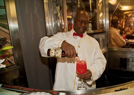 Stock Photo: 1599-31554 African American Porter reenactor pours cherry soda on Pearl Harbor Day Troop train reenactment from Los Angeles Union Station to San Diego