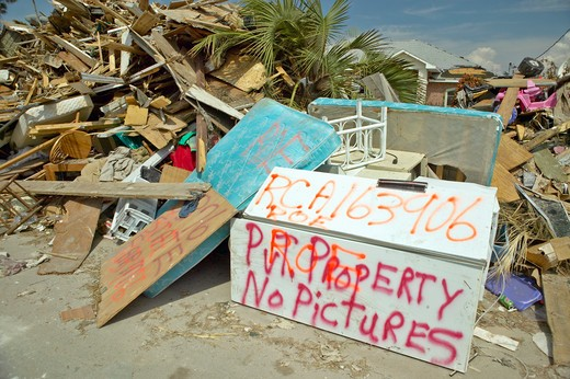 No pictures sign and debris in front of house heavily hit by Hurricane Ivan in Pensacola Florida : Stock Photo