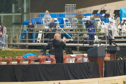 Stock Photo: 1599-4428 A solo trumpeter performs on stage during the official opening ceremony of the Clinton Presidential Library November 18, 2004 in Little Rock, AK