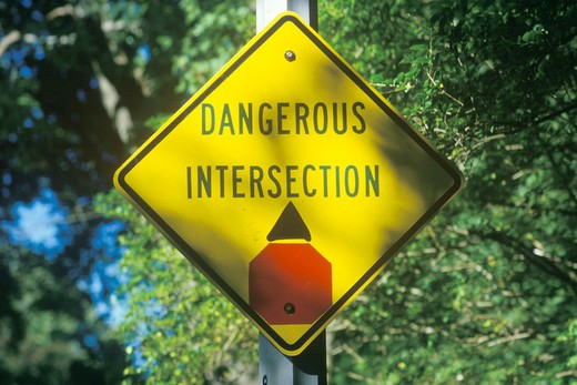 A dangerous intersection road sign : Stock Photo