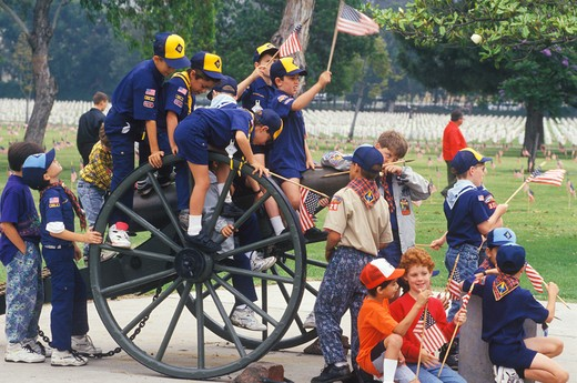 Cub Scouts Playing on Cannon, Veteran's National Cemetery, Los Angeles, California : Stock Photo