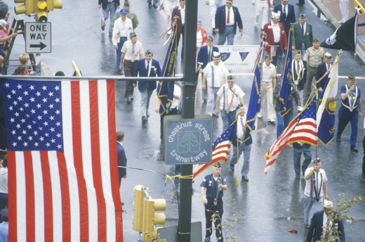 American Flag and Veterans Marching in Parade, United States of America : Stock Photo
