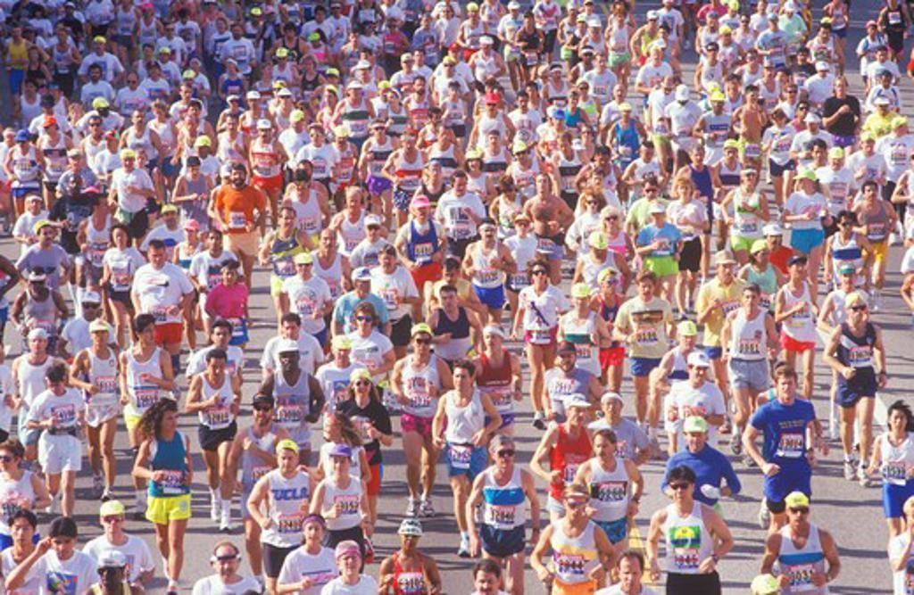 Stock Photo: 1599-6270 Runner on finish line being congratulated, Los Angeles Marathon, Los Angeles, CA
