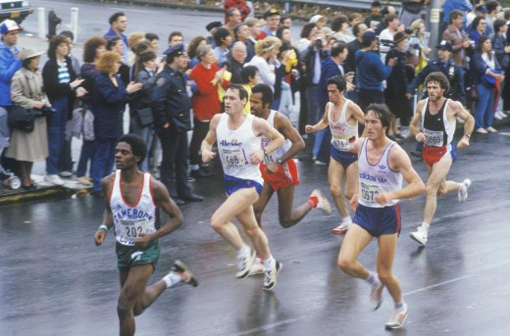 Runners in rain, NY City Marathon, Brooklyn, NY : Stock Photo