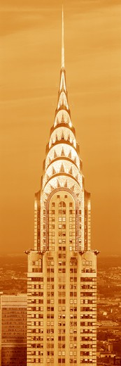 Stock Photo: 1599-6622 This is a sepiatone close up of the Chrysler Building at sunset. It is the view from 42nd Street and 5th Avenue.