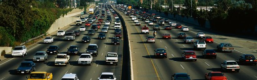 This is rush hour traffic on the 405 Freeway at sunset. There are 10 total lanes of traffic with cars traveling in both directions. : Stock Photo