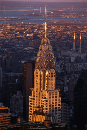 This is the skyline with the Chrysler Building prominent in the center. It is sunset on the city. : Stock Photo
