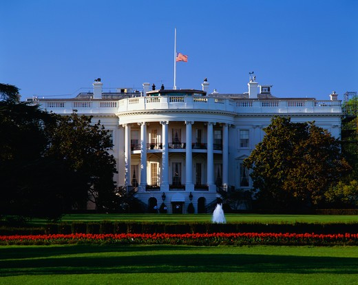 This is the White House in daylight during the summer. It is located on Pennsylvania Avenue. This is the home of the President of the United States. : Stock Photo