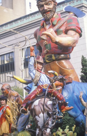 Parade float with Cowboy on bucking bronco and Paul Bunyan characters in Macy's Thanksgiving Day Parade, New York City, New York : Stock Photo