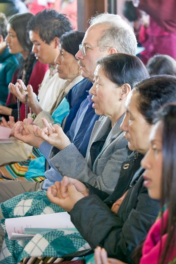 Stock Photo: 1599-7882 Devotees hold prayer beads and rice during an Amitabha Empowerment Buddhist Ceremony, Meditation Mount in Ojai, CA