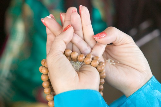 Stock Photo: 1599-7883 A woman's hands hold prayer beads and rice at an Amitabha Empowerment Buddhist Ceremony, Meditation Mount in Ojai, CA