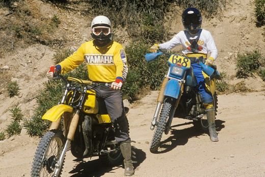 Stock Photo: 1599-7959 Two dirt bike riders on their off-road motorcycles