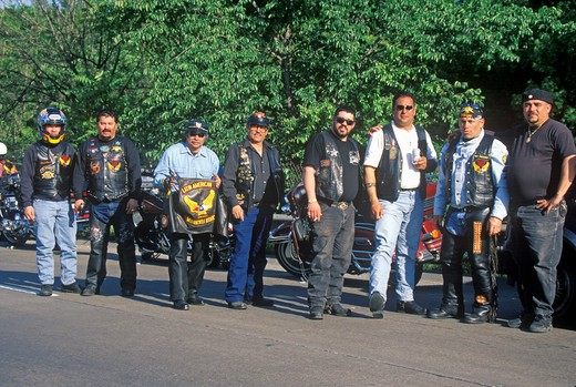 A group of men with their Harley Davidsons from the Latin American Motorcycle Association take a break in Dallas, Texas during their trek from Chicago to Guadalajara : Stock Photo