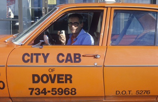 A man in an orange cab in Dover, Delaware : Stock Photo