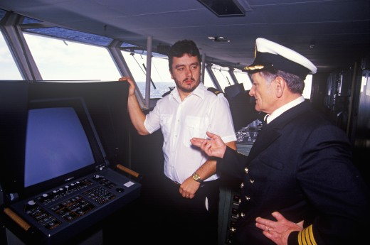 Stock Photo: 1599-8122 The captain of the ferry Bluenose and a crew member standing before an instrument on the bridge