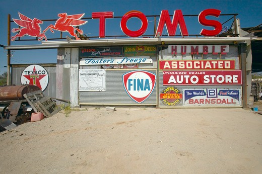 Old antique gas signs of on automobile shop near Barstow, CA off of Route 58 : Stock Photo