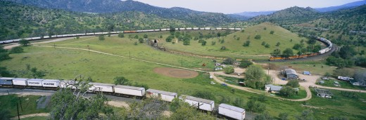 Stock Photo: 1599-8295 The Tehachapi Train Loop near Tehachapi California is the historic location of the Southern Pacific Railroad where freight trains gain 77 feet in elevation and show freight cars traveling in giant loop