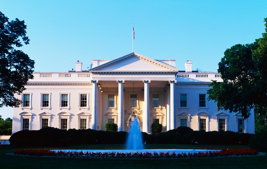 This is the White House in daylight. We see the fountain running in front. It is located on Pennsylvania Avenue. This is the home of the President of the United States. : Stock Photo