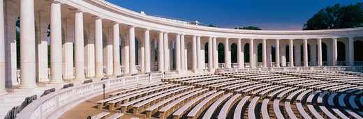 These are the marble columns and the amphitheatre at Arlington National Cemetery. Below the columns are bench seats. : Stock Photo