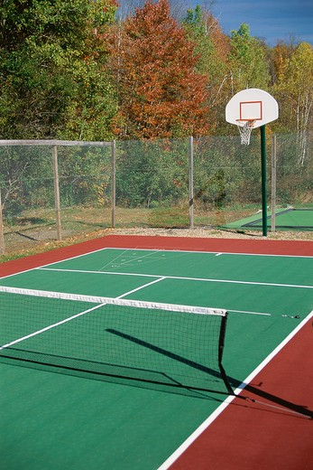 Stock Photo: 1599R-15980 Tennis court with basketball hoop