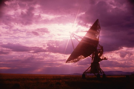 Stock Photo: 1599R-16095 VLA Very Large Array radio telescope dishes against purple sky