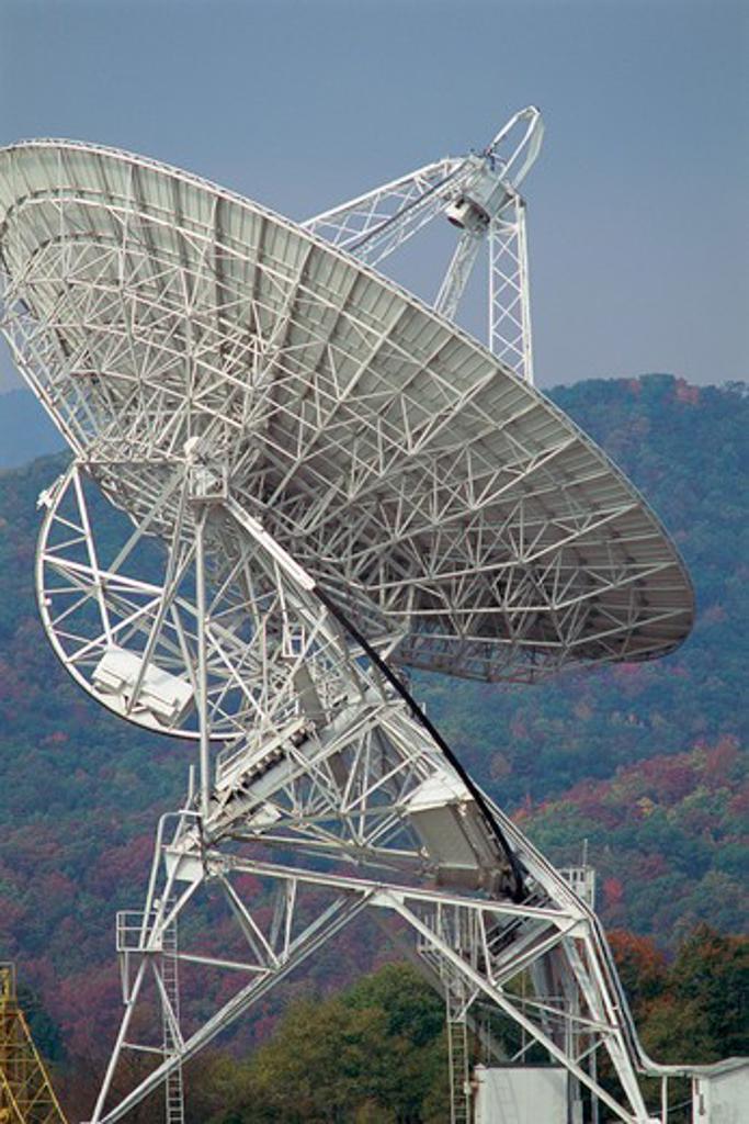Array/satellite dish with mountain beyond : Stock Photo