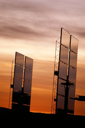 Stock Photo: 1599R-16208 Upright solar panels against sunset