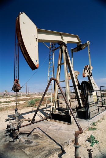 Pump jack at oil well : Stock Photo