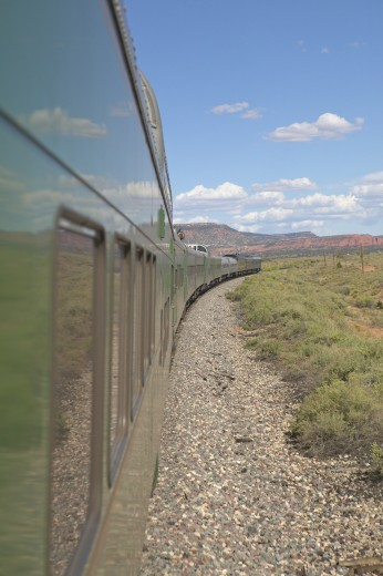 Whistle Stop Kerry Express across America train moving through landscape, American Southwest : Stock Photo