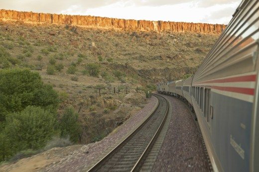 Stock Photo: 1599R-17705 Whistle Stop Kerry Express across America train moving through landscape, American Southwest
