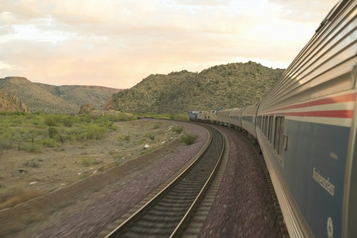 Stock Photo: 1599R-17706 Whistle Stop Kerry Express across America train moving through landscape, American Southwest