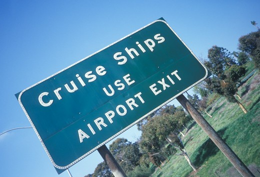 Stock Photo: 1599R-18038 A sign that reads ?Cruise Ships use airport exit?