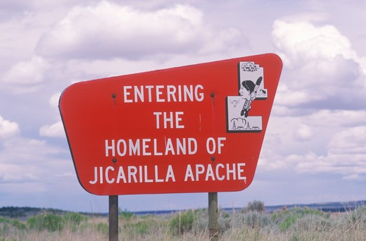 Bright red sign Entering the Homeland of Jicarilla Apache in NM : Stock Photo