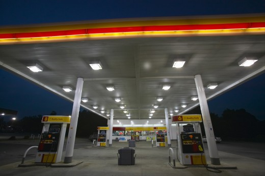 Stock Photo: 1599R-20181 Gas Station with lights on and mini-mart at dusk in Central GA