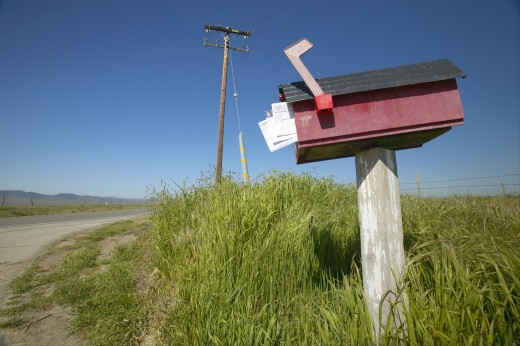 Stock Photo: 1599R-20209 Red box with mail displayed, off the road near old Route 58 near the Carrizo Plains National Monument, CA