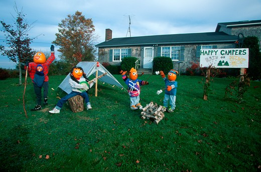 Pumpkin Characters Camping on Front Lawn of House, Maine : Stock Photo