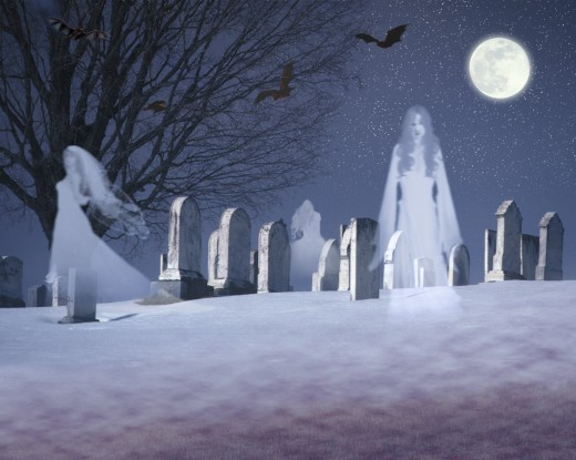 Composite image of ghosts and bats under a full moon in a snowy cemetery, VT : Stock Photo