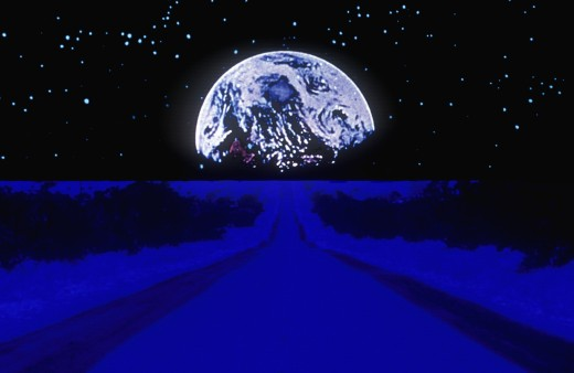 Earth against a starry background above a glowing blue highway extending to the horizon : Stock Photo