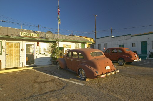 Stock Photo: 1599R-23730 Historic vintage roadside motel on old Route 66 welcomes old cars and guests in Barstow California