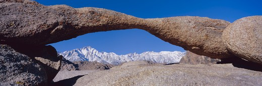 Panoramic view of Mount Whitney framed through Alabama Hills Arch in Alabama Hills near Lone Pine, California : Stock Photo