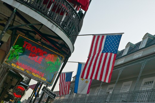 Stock Photo: 1599R-24412 Tropical Isle neon sign and US Flag in French Quarter of New Orleans, Louisiana
