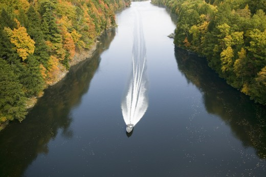Stock Photo: 1599R-24522 A boat navigates the Connecticut River through autumn color on the Mohawk Trail of western Massachusetts, New England