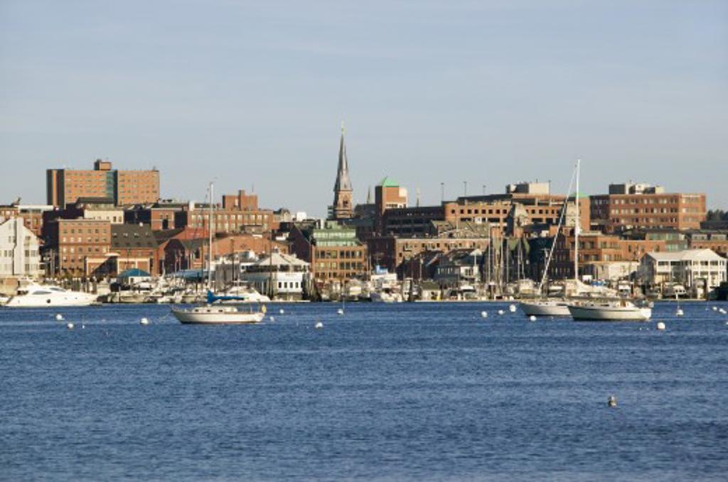 View of Portland Harbor boats with south Portland skyline, Portland, Maine : Stock Photo
